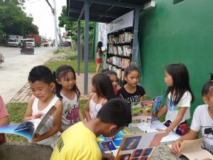 children reading at the street library