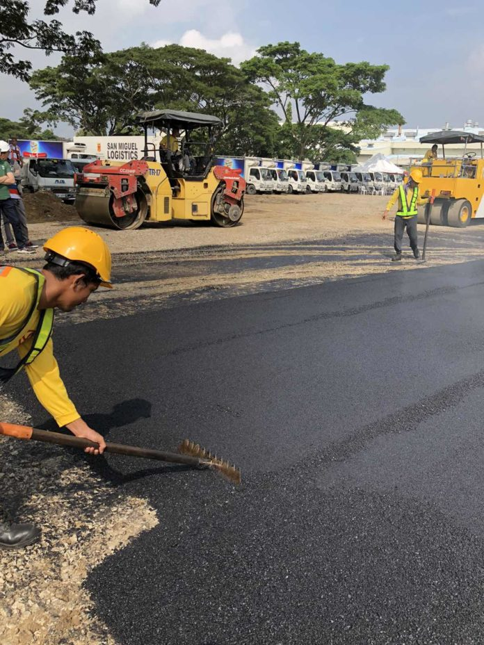 San Miguel Begins First Recycled Plastic Road in PH
