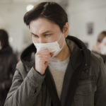 Front view of people with medical masks coughing | Freepik