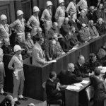 Hermann Göring at the Nürnberg trials Former Nazi leader Hermann Göring standing in the prisoner's box during the Nürnberg trials. | AP Images